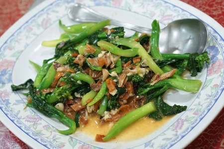 Stir fried chinese Kale with salted fish and dried squid. (With selective focus) Stock Photo