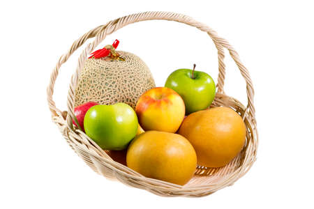 Bunch of fruits in the basket on white background