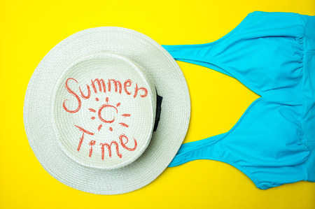 Swimsuit and hat for summer time Stock Photo