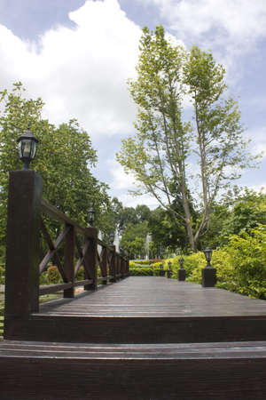 Bridge wood in garden a opening in the trees Stock Photo