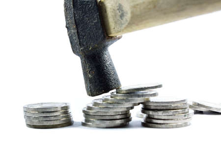 arbitrater: Hammer pound coins on white background