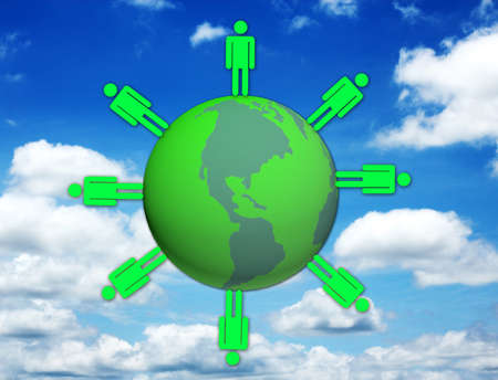 Hand selecting green world on blue sky background