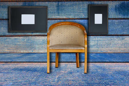 a chair and old frame on old wood background photo