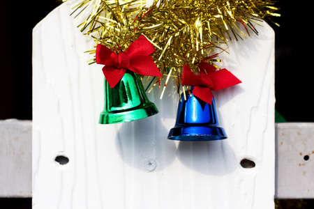 green and red bell for christmas on wood wall background photo