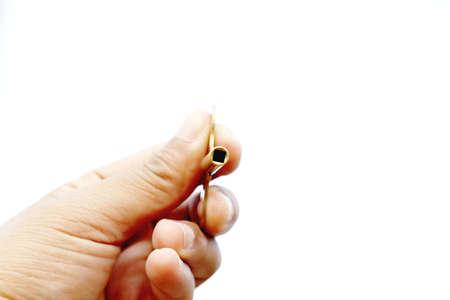 hand holding key on isolated on white background Stock Photo
