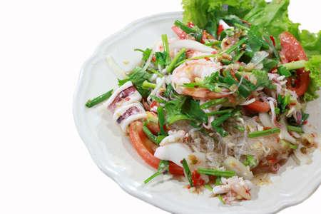 seafood marinated salad on isolate white  photo