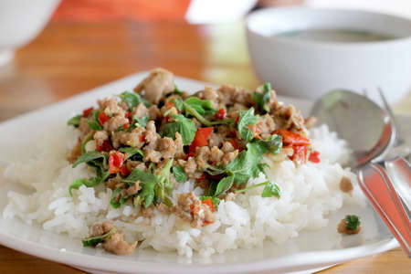 thai food  Fried basil leave with pork on rice  photo