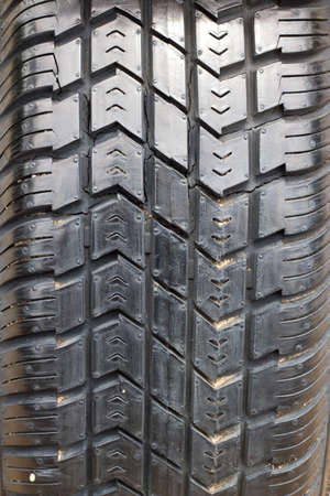 tread: Tread patterns on old worn car tires