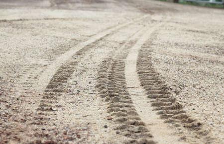 4 wheel tracks detail on ground photo