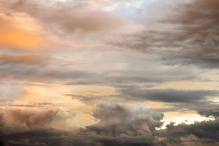 Bright and dark clouds looks like enigmatic figures in sky photo