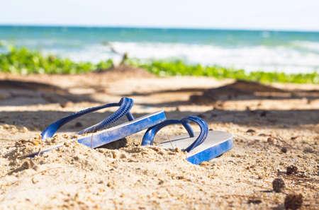 flip flops on a tropical beach