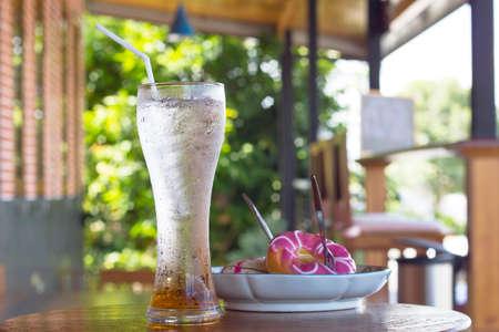 iced kiwi juice on wood background