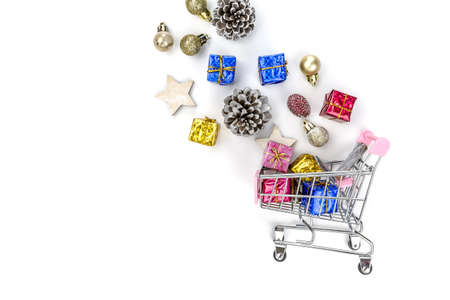 Christmas composition. Christmas gifts on cart, pine branches, toys on white background. Flat lay, top view. Banco de Imagens