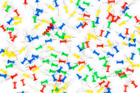 Set of push pins in different colors. frame of thumbtacks on white. Top view.Push pins isolated on white background. colourful push-pin thumbtack tools office on white background