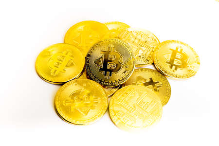 Bitcoin coin golden coin,stack of cryptocurrencies bitcoin isolated on white background,Bitcoin coin golden coin.Set of cryptocurrencies with a golden bitcoin on the front as the leader. Bitcoin as most important cryptocurrency concept. Stock Photo