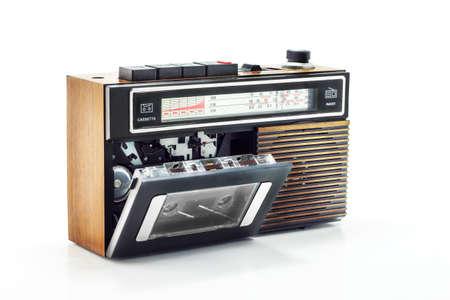 Retro radio and cassette player on table Foto de archivo