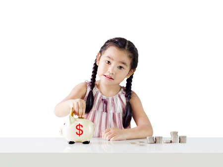 Asian little girl saving money in a piggy bank,education and money saving concept. Isolated on white background