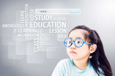 internet explorer: Cute little girl with glasses looking at virtual screens.E-Learning and Online Education.Searching system and internet concept