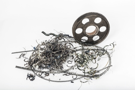 filings: Μetal gear on a white background with metal filings Stock Photo