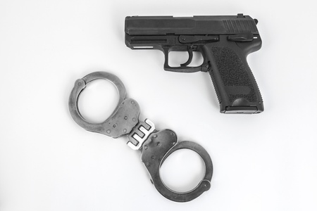 gun and handcuffs with white background photo