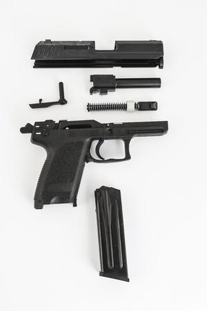disassembled gun, pistol, on white background photo
