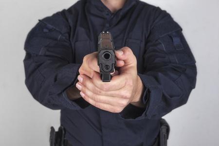 semi automatic: Policeman with gun