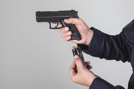 reloaded: Policeman reloaded his gun