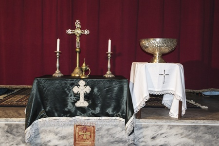 Elements of the holly  vessels on an altar against in the background  host, chalice, candle, cross and altar photo