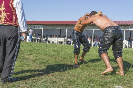 wrestlers: HILIA EVROS, GREECE - AUGUST 18:Unidentified wrestlers in the Annual Oil Wrestling Event in HILIA-EVROS on August 18, 2013 in Hilia Evros, Greece