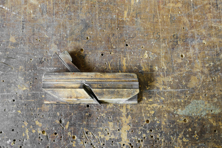 planer: Old carpenter tool planer on a vintage wooden background