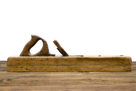 old plane: Old plane, isolated on a wooden background Stock Photo