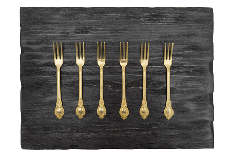 grunge silverware: Vintage forks on a black background Stock Photo