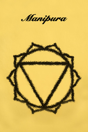 manipura: Manipura chakra.Isolated on yellow background