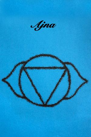 ajna: Ajna chakra.Isolated on blue background Stock Photo