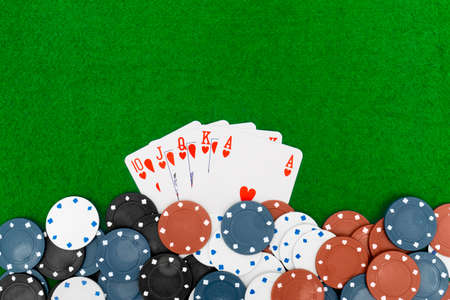 royal flush: Playing cards isolated on green background, Royal Flush