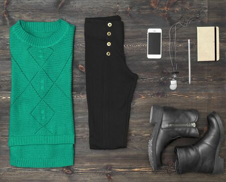 composed: Woman outfit on wooden background