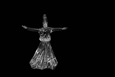 whirling: Whirling dervish isolated on black background