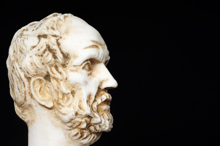 mathematician: White marble bust of the greek philosopher Dimokritos, isolated on black