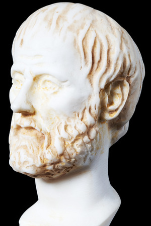 philosopher: White marble bust of the greek philosopher Aristoteles, isolated on black Stock Photo