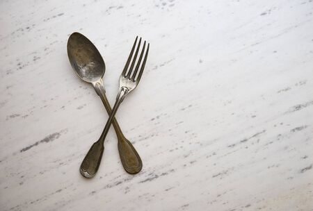 grunge cutlery: Vintage cutlery on white marble background Stock Photo