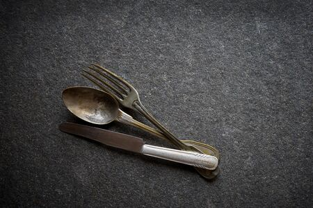 vintage cutlery: Vintage cutlery on black marble background