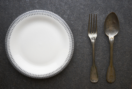 vintage cutlery: Vintage cutlery and plate on black marble background Stock Photo