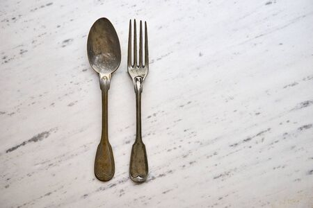 vintage cutlery: Vintage cutlery on white marble background Stock Photo