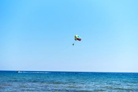 corfu: Parasailing at Issos beach in Corfu, Greece. Stock Photo