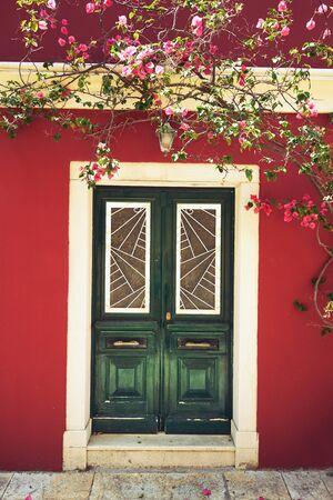 Old traditional   greek house with flowers of bougainvillea, Corfu, Greece