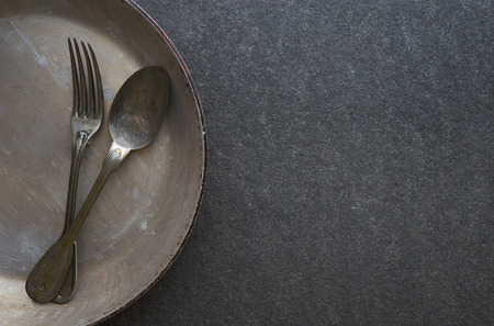 vintage cutlery: Vintage cutlery in old pan on black marble background Stock Photo