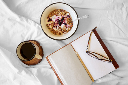 Breakfast with coffee in bed top view Stock Photo