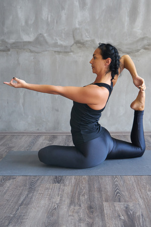asana: Woman practicing yoga in various poses (asana) Stock Photo