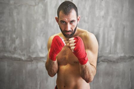 boxing tape: Shot of wrapped hands  with red boxing tape of young boxer fighter