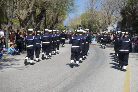 CORFU, GREECE - MARCH 25, 2017: Sailors army in the customary lament procession on the morning of national day of freedom, at the old town of Corfu.
